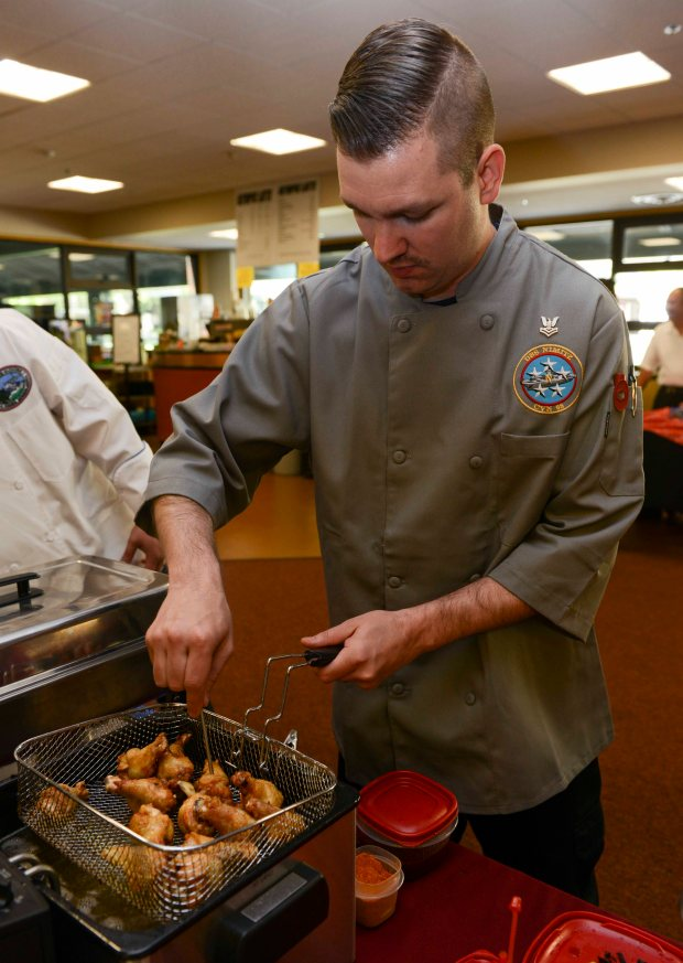 BREMERTON, Wash. (May 9, 2015) Culinary Specialist 2nd Class Richard Leblanc, assigned to the aircraft carrier USS Nimitz (CVN 68), fries chicken wings for the 23rd Annual Armed Forces Culinary Arts Competition at Olympic College. Nimitz is currently undergoing a planned incremental availability at Puget Sound Naval Shipyard and Intermediate Maintenance Facility where the ship will receive scheduled maintenance and upgrades (U.S. Navy photo by Mass Communication Specialist 3rd Class Holly L. Herline/Released)