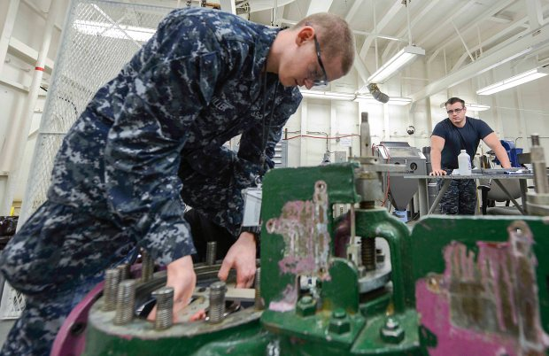 NAVAL BASE KITSAP-BREMERTON, Wash. (May 26. 2015) -- Fireman Austen Miller, assigned to USS Nimitz (CVN 68) and a native of Colorado Springs, Colo. checks the seal on inner components of a valve while working on the valve repair team. The USS Nimitz recently implemented the pilot program Navy Afloat Maintenance Training Strategy (NAMTS) onboard that allows Sailors to join special teams including watertight door team, pump repair team, valve repair team, inside machinist team and outside electrical team to get critical NECs while in extended period intermittent maintenance availability (EPIA). (U.S. Navy photo by Mass Communication Specialist MC3 William J. Blees/Released)