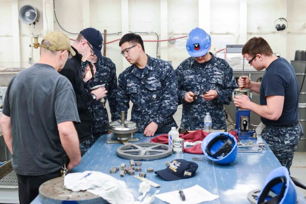 NAVAL BASE KITSAP-BREMERTON, Wash. (May 26, 2015) -- USS Nimitz (CVN 68) Sailors perform maintenance on an air valve while temporarily assigned to the valve repair team as a part of the Navy Afloat Maintenance Training Strategy's (NAMTS) valve repair course. Nimitz recently implemented the pilot program NAMTS which allows Sailors to join special teams including the watertight doors, pump repair, valve repair, inside machinist, and outside electrical to earn critical Navy Enlisted Classifications while the ship is in an extended planned incremental maintenance availability. (U.S. Navy photo by Mass Communication Specialist MC3 William J. Blees/Released)