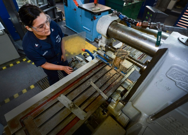 NAVAL BASE KITSAP-BREMERTON, Wash. (May 28, 2015) -- Machinery Repairman 3rd Class Nyla Murphy, assigned to USS Nimitz (CVN 68) and a native of Winslow, Ariz., performs plain milling on a piece of brass as part of the Navy Afloat Maintenance Training Strategy's (NAMTS) inside machinist training. Nimitz recently implemented the pilot program NAMTS, which allows Sailors to join special teams including watertight door, pump repair, valve repair, inside machinist and outside electrical to get critical Navy Enlisted Classifications while in extended planned incremental maintenance availability.  (U.S. Navy photo by Mass Communication Specialist MC3 William J. Blees/Released)