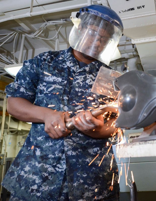 NAVAL BASE KITSAP-BREMERTON, Wash. (May 28, 2015) -- Machine Repairman 3rd Class Naseer Thompson, assigned to USS Nimitz (CVN 68) and a native of Sacramento, Calif., sharpens a piece of equipment on a bench grinder as part of the Navy Afloat Maintenance Training Strategy's (NAMTS) inside machinist training. Nimitz recently implemented the pilot program NAMTS, which allows Sailors to join special teams including watertight door, pump repair, valve repair, inside machinist and outside electrical to get critical Navy Enlisted Classifications while in extended planned incremental maintenance availability. (U.S. Navy photo by Mass Communication Specialist MC3 William J. Blees/Released)