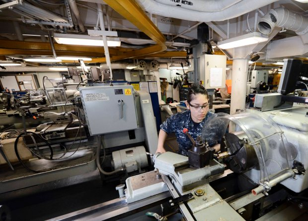 NAVAL BASE KITSAP-BREMERTON, Wash. (May 28, 2015) --Machine Repairman Fireman Amber Nieves, assigned to USS Nimitz (CVN 68) and a native of Rialto, Calif., turns down a bearing on a lathe as part of the Navy Afloat Maintenance Training Strategy's (NAMTS) inside machinist training. Nimitz recently implemented the pilot program NAMTS, which allows Sailors to join special teams including watertight door, pump repair, valve repair, inside machinist and outside electrical to get critical Navy Enlisted Classifications while in extended planned incremental maintenance availability. (U.S. Navy photo by Mass Communication Specialist MC3 William J. Blees/Released)