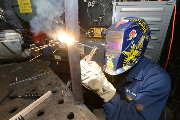 150817-UM507-044  NAVAL BASE KITSAP-BREMERTON, Wash. (August 18, 2015) - Hull Maintenance Technician Fireman Andrew Mendez, a native of Paso Robles, Calif., welds metal in the machine shop aboard the aircraft carrier USS Nimitz (CVN 68). Nimitz is currently undergoing a planned incremental availability at Puget Sound Naval Shipyard and Intermediate Maintenance Facility. (U.S. Navy photo by Mass Communication Specialist Seaman Apprentice Weston A. Mohr/Released)