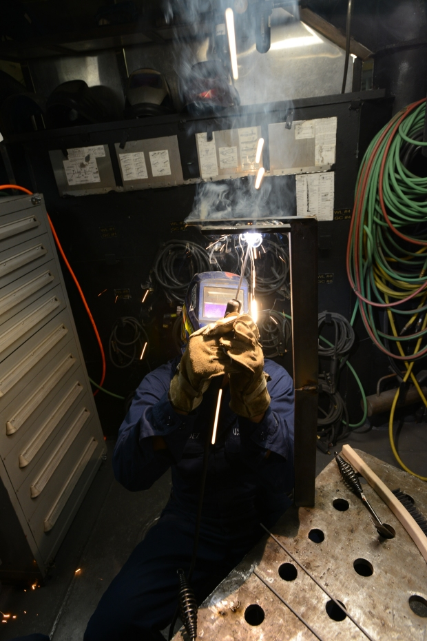 150817-UM507-064 NAVAL BASE KITSAP-BREMERTON, Wash. (August 18, 2015) - Hull Maintenance Technician Fireman Andrew Mendez, a native of Paso Robles, Calif., welds metal in the machine shop aboard the aircraft carrier USS Nimitz (CVN 68). Nimitz is currently undergoing a planned incremental availability at Puget Sound Naval Shipyard and Intermediate Maintenance Facility. (U.S. Navy photo by Mass Communication Specialist Seaman Apprentice Weston A. Mohr/Released)