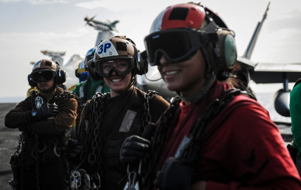MEDITERRANEAN SEA (Nov. 7, 2013) Sailors pause for a moment during flight operations on the flight deck of the aircraft carrier USS Nimitz (CVN 68). Nimitz is deployed supporting maritime security operations and theater security cooperation efforts in the U.S. 6th Fleet area of operations. (U.S. Navy photo by Mass Communication Specialist Seaman Siobhana R. McEwen/ Released)