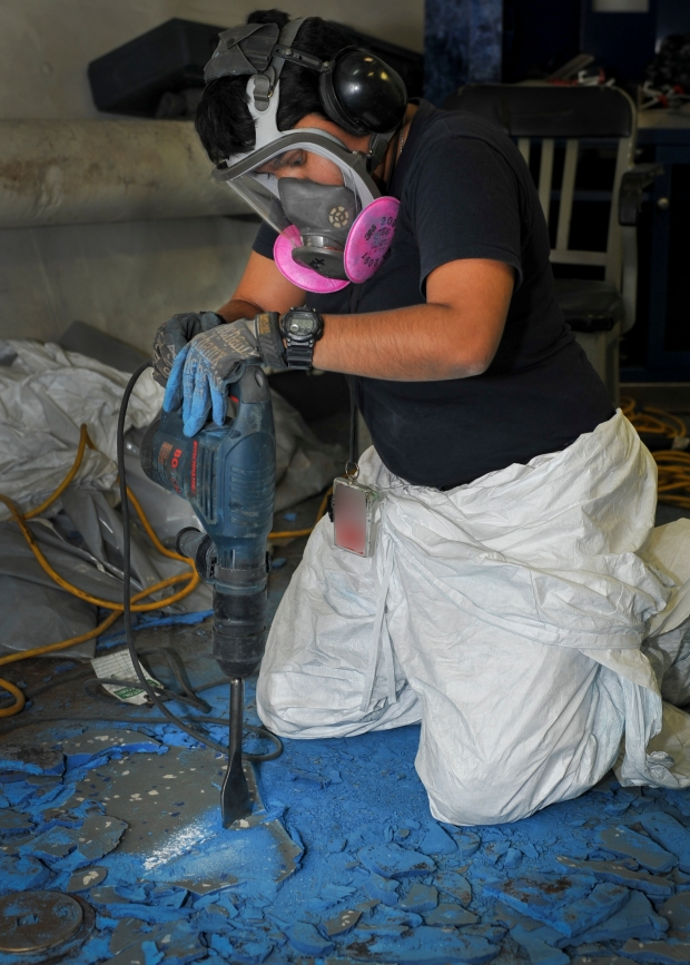 150825-N-ZZ999-010 NAVAL BASE KITSAP-BREMERTON, Wash. (August 25, 2015) – Ship's Serviceman Seaman Grecia Colmenares Gaytan, a native of La Porte, Texas., breaks apart old deck tile aboard the aircraft carrier USS Nimitz (CVN 68). Nimitz is currently undergoing a planned incremental availability at Puget Sound Naval Shipyard and Intermediate Maintenance Facility. (U.S. Navy photo by Mass Communication Specialist Seaman Chad D. Anderson/Released)