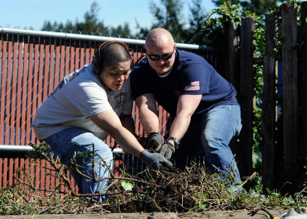 NAVAL BASE KITSAP-BREMERTON, Wash. (March 29, 2016) – Chief Electrician's Mate Marvin Frilles (left) and Chief Gunner's Mate Greg Waite, both assigned to USS Nimitz (CVN 68), remove overgrown shrubs at the American Legion in Bremerton, Wash. during a campus cleanup in honor of the birthday of the Chief Petty Officer. The rank of chief petty officer has been in place for 123 years, and was created as a way to promote deck plate leadership throughout the fleet. Nimitz is currently undergoing extended planned incremental maintenance availability at Puget Sound Naval Shipyard and Intermediate Maintenance Facility where the ship is receiving scheduled maintenance and upgrades.  (U.S. Navy photo by Mass Communication Specialist Seaman Erickson B. Magno/ Released)