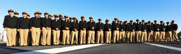 NAVAL BASE KITSAP – BREMERTON (April 1, 2016) Chief Petty Officers assigned to the aircraft carrier USS Nimitz (CVN 68) stand in formation after morning colors on the flight deck, in honor of the birthday of the Navy chief. The rank of chief petty officer was established 123 years ago, and was created as a way to promote deck plate leadership throughout the fleet. Nimitz is currently undergoing an extended planned incremental maintenance availability at Puget Sound Naval Shipyard and Intermediate Maintenance Facility where the ship is receiving scheduled maintenance and upgrades.  (U.S. Navy photo by Mass Communication Specialist Seaman