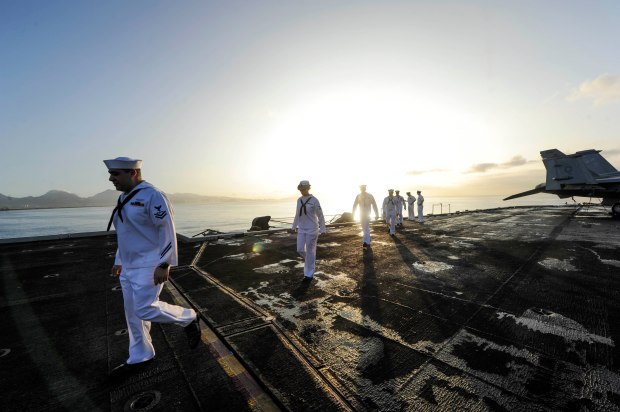 PEARL HARBOR (Dec. 3, 2013) Sailors man the rails of the aircraft carrier USS Nimitz (CVN 68) as the ship enters Pearl Harbor. Nimitz is in Pearl Harbor for a scheduled port visit during their transit home after an eight-month deployment to the U.S. 5th, 6th, and 7th Fleet areas of responsibility. (U.S. Navy photo by Mass Communication Specialist Seaman Aiyana S. Paschal/Released)