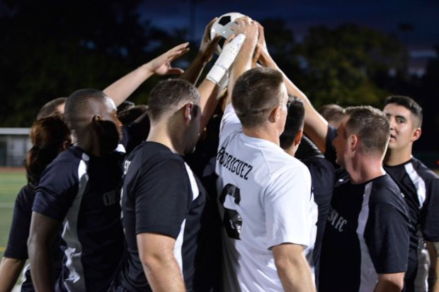 NAVAL BASE KITSAP-BREMERTON, Wash. (Aug. 31, 2016) Chester Football Club Alpha, an official soccer team of USS Nimitz (CVN 68) celebrates their 2016 Naval Base Kitsap Soccer League Championship win. Nimitz is currently undergoing an extended planned incremental maintenance availability at Puget Sound Naval Shipyard and Intermediate Maintenance Facility where the ship is receiving scheduled maintenance and upgrades. (U.S. Navy photo by Mass Communication Specialist 3rd Class Erickson B. Magno/Released)