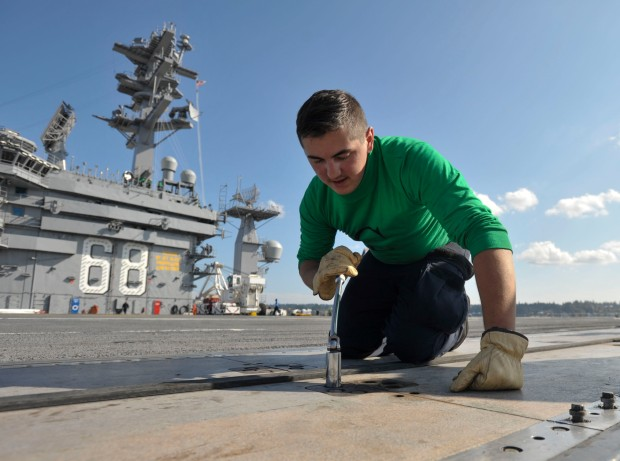 NAVAL BASE KITSAP-BREMERTON, Wash., -(September 30, 2016) Seaman John Washburn, a native of Byroncenter, Mich., is preforming corrective maintenance on a catapult on the flight deck of the USS Nimitz (CVN 68). Nimitz is currently undergoing an extended planned incremental maintenance availability at Puget Sound Naval Shipyard and Intermediate Maintenance Facility where the ship is receiving scheduled maintenance and upgrades. (U.S. Navy photo by Seaman David Claypool/Released)