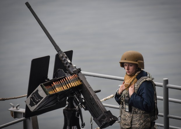 NAVAL BASE KITSAP-BREMERTON, Wash. – (Oct. 5, 2016) Seaman Kassandra Verhaag, of Springdale, Wash., stands watch with a .50-caliber machine gun as USS Nimitz (CVN 68) departs Puget Sound Naval Shipyard to conduct sea trials as part of the completion of a 20-month extended planned incremental availability. Once Nimitz completes sea trials, the ship will begin a training and qualification cycle in preparation for an upcoming 2017 deployment. (U.S. Navy photo by Petty Officer 2nd Class Siobhana R. Mcewen /Released)