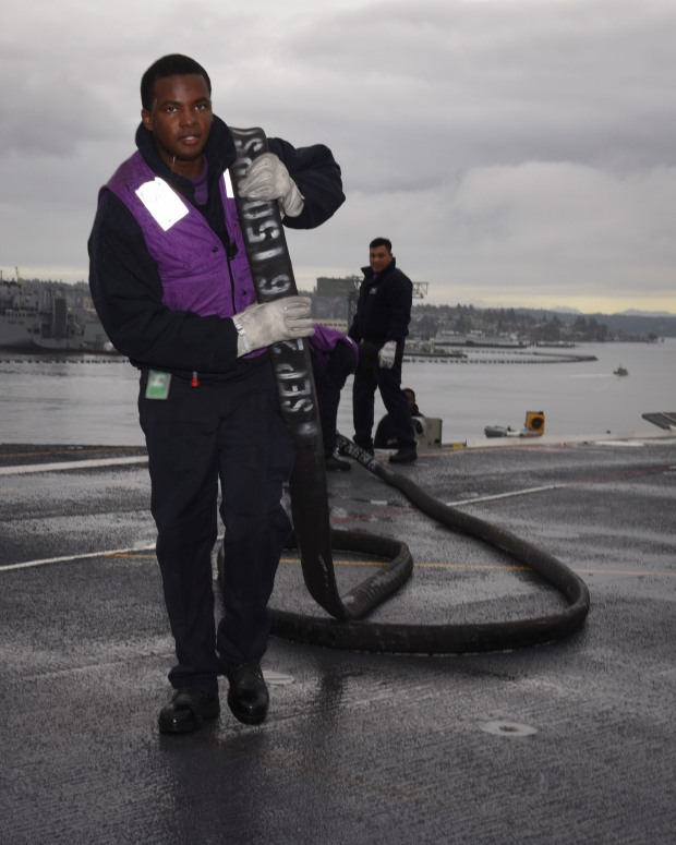NAVAL BASE KITSAP-BREMERTON, Wash. – (Oct. 5, 2016) Seaman Eric Gardner, a native of Cincinnatti, flakes out a fuel hose on the flight deck as USS Nimitz (CVN 68) departs Puget Sound Naval Shipyard to conduct sea trials as part of the completion of a 20-month extended planned incremental availability. Once Nimitz completes sea trials, the ship will begin a training and qualification cycle in preparation for an upcoming 2017 deployment. (U.S. Navy photo by Seaman Weston A. Mohr/Released)