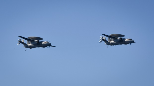 "PACIFIC OCEAN – (Oct. 20, 2016) Two E-2D Hawkeyes, from the ""Bluetails"" of Carrier Airborne Early Warning Squadron (VAW) 121, fly over the aircraft carrier USS Nimitz (CVN 68). Nimitz is underway to complete flight deck certification and carrier qualification for an upcoming 2017 deployment. (U.S. Navy photo by Seaman Weston A. Mohr/Released)"