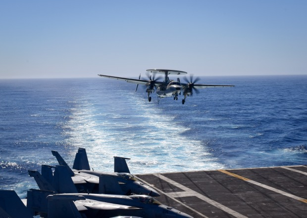 "PACIFIC OCEAN – (Oct. 20, 2016) An E-2D Hawkeye, from the ""Bluetails"" of Carrier Airborne Early Warning Squadron (VAW) 121, prepares to land on the flight deck of the aircraft carrier USS Nimitz (CVN 68). Nimitz is underway to complete flight deck certification and carrier qualification for an upcoming 2017 deployment. (U.S. Navy photo by Seaman Weston A. Mohr/Released)"