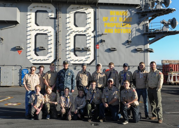 BREMERTON, Wa. (Dec. 20, 2016) - Capt. John Ring, commanding officer of the aircraft carrier USS Nimitz (CVN 68), poses for a group photo with Boy Scout Troop 1498. Nimitz has just returned to port after an underway conducting Tailored Ship's Training Availability and Final Evaluation Problem (TSTA/FEP), which evaluates the crew on their performance during training drills and real-world scenarios. Nimitz will begin Board of Inspection and Survey (INSURV) and Composite Training Unit Exercise (COMPTUEX) in the coming months in preparation for an upcoming 2017 deployment. (U.S. Navy photo by Seaman Leon Wong/Released)