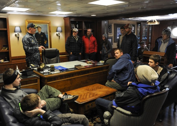 BREMERTON, Wa. (Dec. 20, 2016) - Capt. John Ring, commanding officer of the aircraft carrier USS Nimitz (CVN 68), gives a tour of the ship to Boy Scout Troop 1498. Nimitz has just returned to port after an underway conducting Tailored Ship's Training Availability and Final Evaluation Problem (TSTA/FEP), which evaluates the crew on their performance during training drills and real-world scenarios. Nimitz will begin Board of Inspection and Survey (INSURV) and Composite Training Unit Exercise (COMPTUEX) in the coming months in preparation for an upcoming 2017 deployment. (U.S. Navy photo by Seaman Leon Wong/Released)