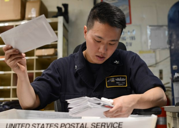 Pacific Ocean (Nov. 28, 2016) - Petty Officer 2nd Class Paul Cha, a native of Rehoboth Beach, Del., sorts newly arrived mail on board USS Nimitz (CVN 68). Nimitz is currently underway conducting Tailored Ship's Training Availability and Final Evaluation Problem (TSTA/FEP), which evaluates the crew on their performance during training drills and real-world scenarios. Once Nimitz completes TSTA/FEP they will begin Board of Inspection and Survey (INSURV) and Composite Training Unit Exercise (COMPTUEX) in preparation for an upcoming 2017 deployment.  (U.S. Navy photo by Petty Officer 3rd Class Samuel Bacon/Released)