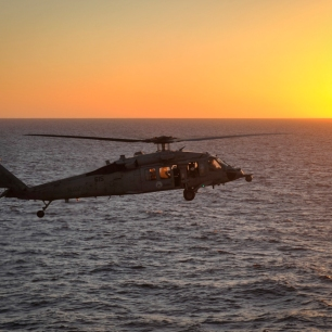 PACIFIC OCEAN (Dec. 3, 2016) An MH-60S Sea Hawk helicopter, from Helicopter Sea Combat Squadron (HSC) 8, prepares to land on the flight deck of the aircraft carrier USS Nimitz (CVN 68). Nimitz is currently underway conducting Tailored Ship's Training Availability and Final Evaluation Problem (TSTA/FEP), which evaluates the crew on their performance during training drills and real-world scenarios. Once Nimitz completes TSTA/FEP they will begin Board of Inspection and Survey (INSURV) and Composite Training Unit Exercise (COMPTUEX) in preparation for an upcoming 2017 deployment. (U.S. Navy photo by Seaman David Claypool/Released)