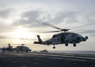 PACIFIC OCEAN (Dec. 6, 2016) - An MH-60R Sea Hawk helicopter from the Wolf Pack of Helicopter Maritime Strike Squadron (HSM) 75 lifts off the flight deck of the aircraft carrier USS Nimitz (CVN 68). Nimitz is currently underway conducting Tailored Ship's Training Availability and Final Evaluation Problem (TSTA/FEP), which evaluates the crew on their performance during training drills and real-world scenarios. Once Nimitz completes TSTA/FEP they will begin Board of Inspection and Survey (INSURV) and Composite Training Unit Exercise (COMPTUEX) in preparation for an upcoming 2017 deployment. (U.S. Navy photo by Petty Officer 3rd Class Samuel Bacon/Released)