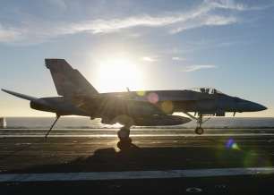 PACIFIC OCEAN (Dec. 7, 2016) - An F/A-18E Super Hornet from the Argonauts of Strike Fighter Squadron (VFA) 147 performs a touch and go on the flight deck of the aircraft carrier USS Nimitz (CVN 68). Nimitz is currently underway conducting Tailored Ship's Training Availability and Final Evaluation Problem (TSTA/FEP), which evaluates the crew on their performance during training drills and real-world scenarios. Once Nimitz completes TSTA/FEP they will begin Board of Inspection and Survey (INSURV) and Composite Training Unit Exercise (COMPTUEX) in preparation for an upcoming 2017 deployment. (U.S. Navy photo by Petty Officer 3rd Class Samuel Bacon/Released)
