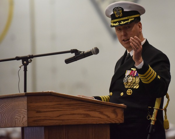 Capt. Kevin Lenox speaks during a change of command ceremony on board USS Nimitz (CVN 68), where he relieved Capt. John Ring as the ship's commanding officer. Ring oversaw the largest work package executed in a planned incremental availability outside of dry-dock, as well as an expedited inter-deployment training cycle during his tour from 2014 to 2017. Lenox will oversee Nimitz through the Board of Inspection and Survey (INSURV) and Composite Training Exercise (COMPTUEX), which will certify Nimitz, Carrier Strike Group 11, Carrier Air Wing 11 and Destroyer Squadron 9 for an upcoming 2017 deployment.(U.S. Navy photo by Mass Communications Specialist 3rd Class Samuel Bacon/Released)