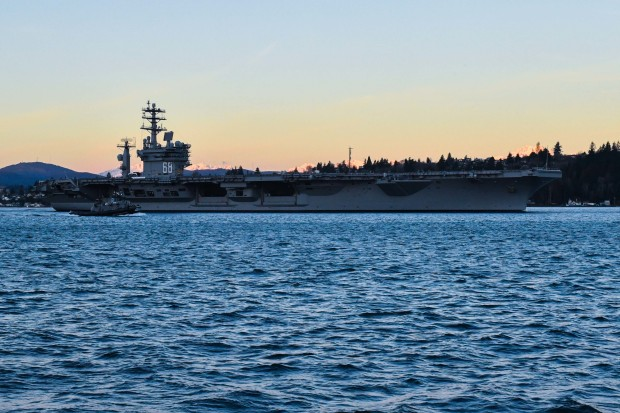 The aircraft carrier USS Nimitz (CVN 68) transits Sinclair Inlet after departing Puget Sound Naval Shipyard. Nimitz is underway conducting the Navy's Board of Inspection and Survey (INSURV), which is a periodic inspection to ensure the ship meets Navy standards. (U.S. Navy photo by Mass Communication Specialist 2nd Class Vaughan Dill/Released)