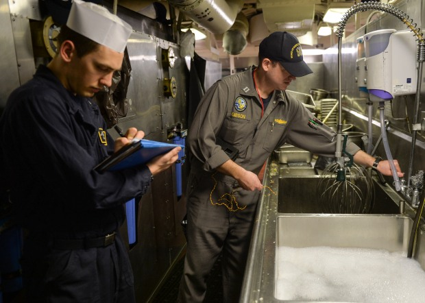 170214-N-JH929-144 PACIFIC OCEAN (Feb. 14, 2017) Lt. Jared Gibson, an inspector from the Board of Inspection and Survey (INSURV), conducts a galley inspection aboard the aircraft carrier USS Nimitz (CVN 68). The ship is undergoing INSURV in preparation for an upcoming deployment. (U.S. Navy photo by Mass Communication Specialist Seaman Cole Schroeder/Released)