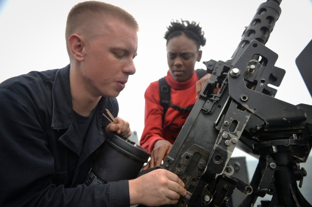Sailors Clean .50-Caliber Machine Gun